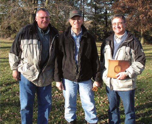 Pictured: Doyle Hostelter with Farmers Coop, Dave Doeschot of Pella Farms, and Nick Swantek of Hubbard Feeds, Inc